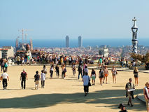 Tourists in Barcelona's background and the Sagrada Familia in Gu royalty free stock images