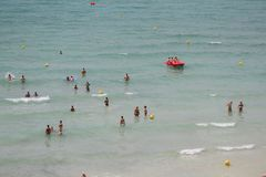 Tourists bath on the sea in El Arenal beach in Mallorca Royalty Free Stock Photo