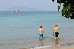 Tourists bathing on the beach in Krabi, southern Thailand Stock Photo