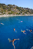 Tourists are bathing in the Mediterranean Sea amidst the shore. Royalty Free Stock Photos