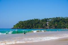 Tourists Bathing in Sea at Mirissa, Sri Lanka Stock Photography