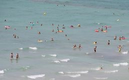 Tourists bathing and swimming in Arenal beach in Mallorca royalty free stock photography