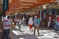 Tourists at the bazaar in Egypt. Tourists walk through the eastern bazaar in Egypt. Bazaar in Luxor, near the temple of Queen Hatshepsut stock photography