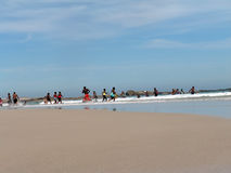 Tourists on beach. Tourists having fun on a beautiful beach Stock Photos