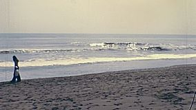 Costa del Sol of Andalusia in 1970s. Tourists on a beach of Costa del Sol for vacation. Historical archival of Andalusia region of Spain in 1970s stock video footage