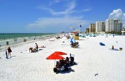 Tourists on the beach enjoying the sun Royalty Free Stock Photos