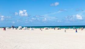 Tourists on beach enjoying sun in south beach Royalty Free Stock Photo