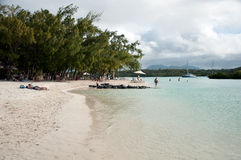 Tourists on the beach Ile aux Cerfs, Mauritius Stock Photography