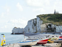 Tourists on beach near cliffs in Etretat town Royalty Free Stock Photography