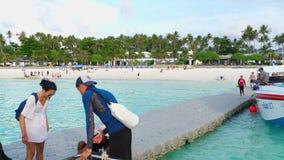Tourists on the beach of Raya Island. KOH RACHA YAI, THAILAND - NOVEMBER 20, 2017: Tourists on the beach of Koh Racha Yai Island stock footage