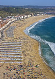Tourists on beach in summer. Aerial view of tourists on resort beach by ocean, summer scene, Portugal Stock Image