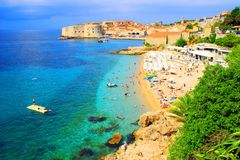 Tourists on beach. Tourists sunbathing on the beach Banje in Dubrovnik, famous touristic destination in Croatia Stock Photos