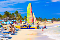 Tourists at the beach of Varadero in Cuba Stock Photos