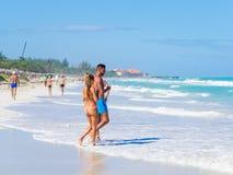 Tourists at the beach of Varadero in Cuba Stock Photos