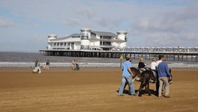 Tourists on the beach West Country holiday resort of Weston-super-Mare last weekend of summer holidays stock footage