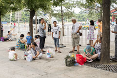 Tourists in Beijing tourism rest beside the road Royalty Free Stock Image