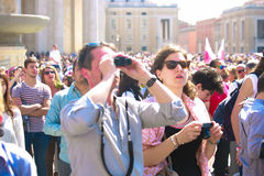 Tourists and believers in Vatican City, Italy Stock Photo