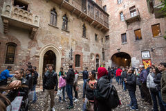 Tourists below the balcony in the Casa di Giulietta Juliet`s House, Via Cappello, Verona, Stock Images