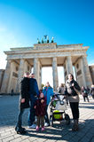 Tourists in Berlin. Tourists visiting Berlin, standing at Brandenburg Gate, looking up Stock Photography