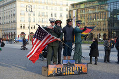 Tourists in Berlin. Tourists posing with actors wearing military uniform. Parizer Platz, berlin, Germany Royalty Free Stock Photo