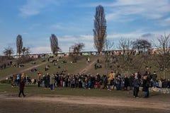 Tourists beside Berlin Wall, Berliner Mauer Stock Images
