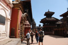 Tourists in Bhaktapur square -  Nepal. Temples of Baktapur square in Nepal Stock Images