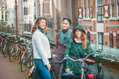 Tourists with bicycles in Amsterdam Royalty Free Stock Images
