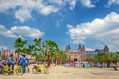 Tourists with bicycles in front of the Rijksmuseum in Amsterdam, Royalty Free Stock Images