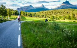 Tourists on bicycles travel to Norway stock image