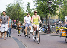 Tourists on bikes in Amsterdam Royalty Free Stock Images