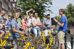 Tourists on bikes in Amsterdam Stock Images