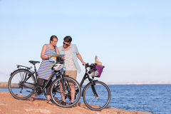 Tourists with bikes looking at map. In Spain stock images