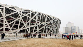 Tourists at the Bird's Nest Stadium. Crowds of tourists walk around the Bird's Nest Stadium in Beijing's Olympic Park Royalty Free Stock Image