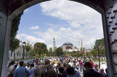 Tourists at the Blue Mosque of Istanbul Stock Photo
