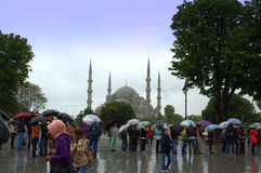 Tourists Blue Mosque rainy day. The Blue Mosque in Istanbul city center,tourists sightseeing  in gloomy rainy day Stock Images