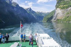 Tourists on board the cruise ship admire spectacular views of the fjord on June 29, 2016 in Geirangerfjord, Norway. Royalty Free Stock Image