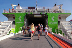 Tourists board on the ferry to Santorini island at the port of H Stock Photo