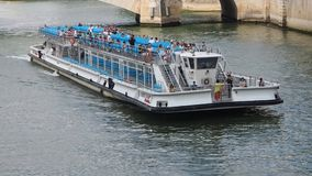 Tourists on board of a river boat visit the French capital. PARIS, FRANCE - JULY 4, 2018: Tourists on board of a river boat visit the French capital on July 4 stock video footage