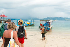Tourists boarding boat island hopping Royalty Free Stock Photos