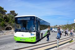 Tourists boarding a bus, Malta. Tourists embarking a bus, Blue Grotto, Malta, Europe Stock Image