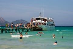 Tourists boarding off a cruise ship at Playa de Muro beach in Alcudia bay. Majorca, Balearic islands, Spain Stock Photography