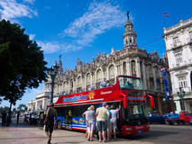 Tourists boarding a sightseeing bus in Havana Royalty Free Stock Photos