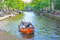 Tourists on a boat in Amsterdam Royalty Free Stock Photography