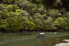 Tourists on a boat in Arashiyama royalty free stock photo