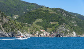 Tourists on a boat arriving to Vernazza, one of the five towns t Royalty Free Stock Image