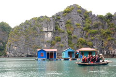Tourists in boat excursion. Ha Long bay. Vietnam Royalty Free Stock Photography