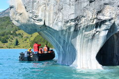 Tourists in a boat in front of Capillas de Mármol rock formations, Chile Stock Image