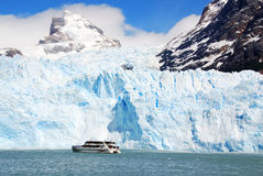 Tourists boat in front the Perito Moreno glacier Stock Photos