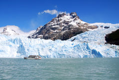 Tourists boat in front the Perito Moreno glacier Royalty Free Stock Photography