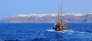 Tourists boat going to Oia, Santorini, Greece Stock Images